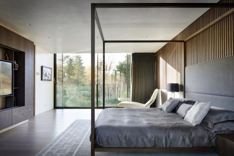 Staircase swing and material details add flair to Highgate house